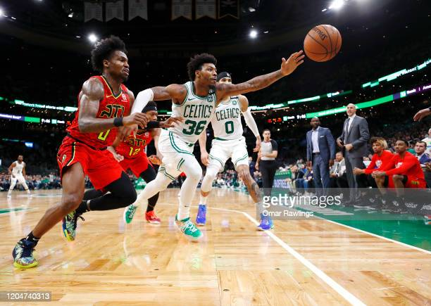 Marcus Smart of the Boston Celtics attempts to save the ball from going out of bounds during the fourth quarter of the game against the Atlanta Hawks...