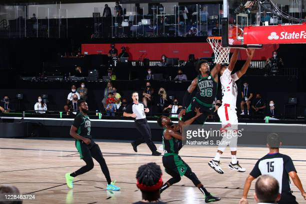 Marcus Smart of the Boston Celtics blocks the shot by Norman Powell of the Toronto Raptors during Game Seven of the Eastern Conference Semifinals of...