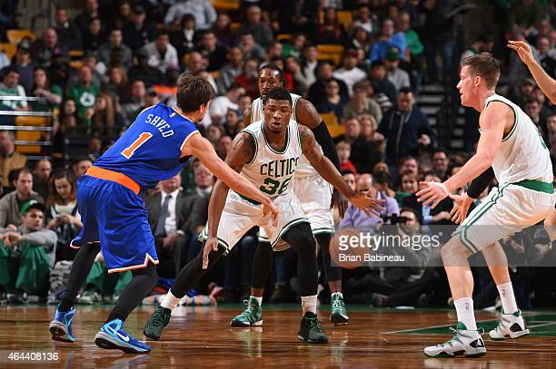 Marcus Smart of the Boston Celtics brings the ball up court against Alexey Shved of the New York Knicks on February 25 2015 at TD Garden in Boston...