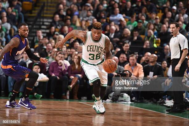 Marcus Smart of the Boston Celtics brings the ball up court against the Phoenix Suns on January 15 2016 at the TD Garden in Boston Massachusetts NOTE...