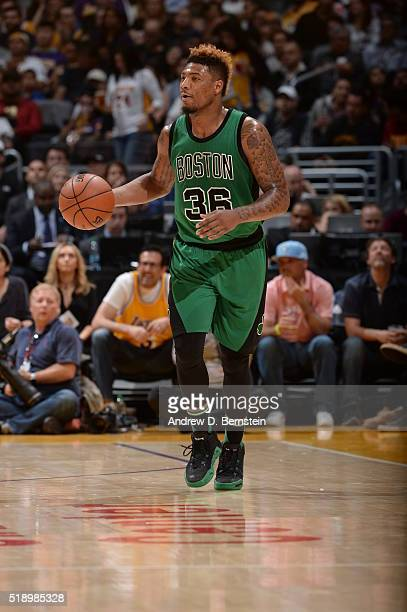 Marcus Smart of the Boston Celtics brings the ball up court against the Los Angeles Lakers on April 3 2016 at STAPLES Center in Los Angeles...