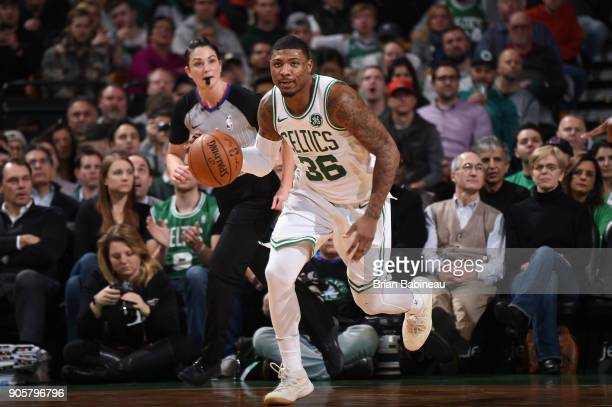 Marcus Smart of the Boston Celtics brings the ball up court against the New Orleans Pelicans on January 16 2018 at the TD Garden in Boston...