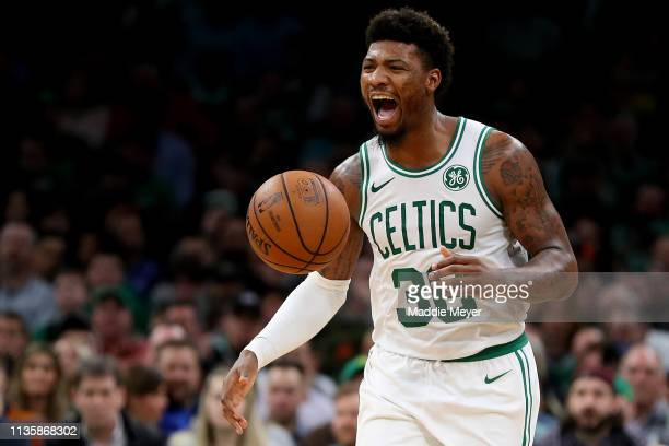 Marcus Smart of the Boston Celtics celebrates during the second half against the Sacramento Kings at TD Garden on March 14 2019 in Boston...