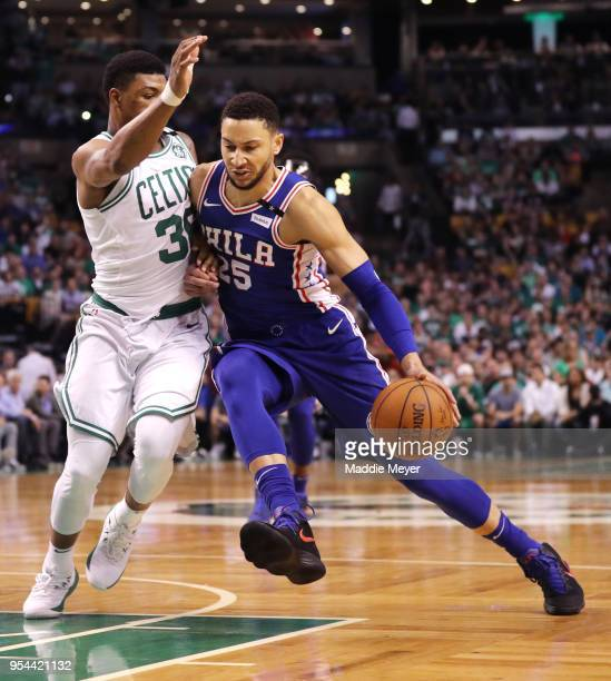 Marcus Smart of the Boston Celtics defends Ben Simmons of the Philadelphia 76ers during the first quarter of Game Two of the Eastern Conference...