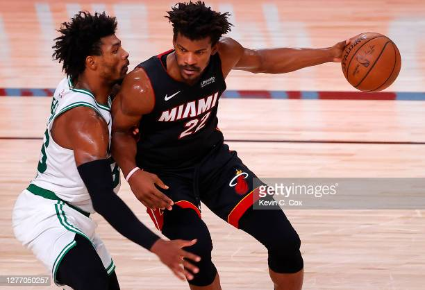 Marcus Smart of the Boston Celtics defends Jimmy Butler of the Miami Heat in Game Six of the Eastern Conference Finals during the 2020 NBA Playoffs...