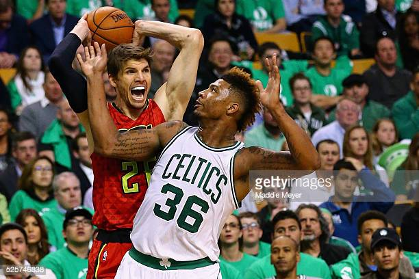 Marcus Smart of the Boston Celtics defends Kyle Korver of the Atlanta Hawks during the fourth quarter of Game Six of the Eastern Conference...