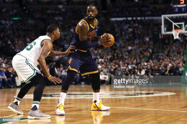 Marcus Smart of the Boston Celtics defends LeBron James of the Cleveland Cavaliers during the first quarter at TD Garden on March 1 2017 in Boston...