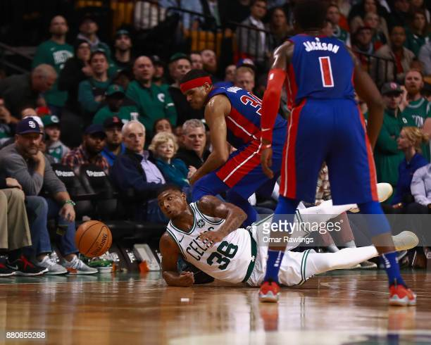 Marcus Smart of the Boston Celtics dives for a ball during the forth quarter of the game against the Detroit Pistons at TD Garden on November 27 2017...
