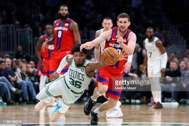 Marcus Smart of the Boston Celtics dives for a loose ball ahead of Sviatoslav Mykhailiuk of the Detroit Pistons at TD Garden on January 15 2020 in...