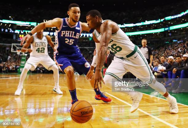Marcus Smart of the Boston Celtics dribbles against Ben Simmons of the Philadelphia 76ers during the first half of their game at TD Garden on January...