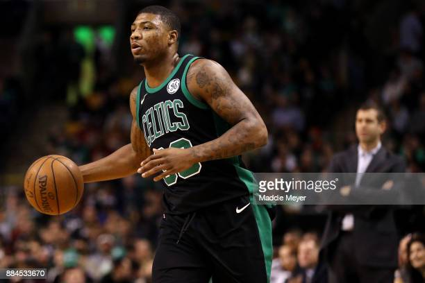 Marcus Smart of the Boston Celtics dribbles against the Phoenix Suns during the first half at TD Garden on December 2 2017 in Boston Massachusetts