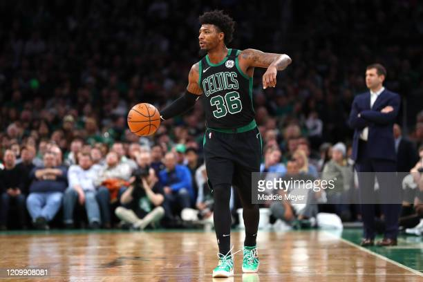 Marcus Smart of the Boston Celtics dribbles downcourt during the second half of the game at TD Garden on February 29 2020 in Boston Massachusetts The...