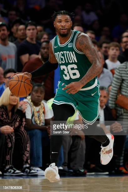 Marcus Smart of the Boston Celtics dribbles during first overtime against the New York Knicks at Madison Square Garden on October 20, 2021 in New...