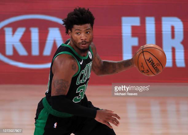 Marcus Smart of the Boston Celtics dribbles the ball during the third quarter against the Toronto Raptors in Game Seven of the Eastern Conference...