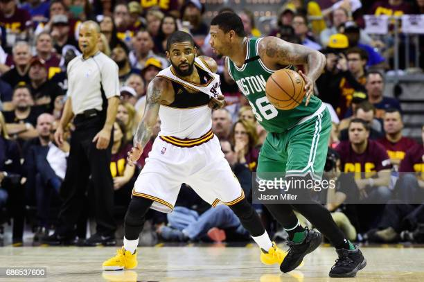 Marcus Smart of the Boston Celtics drives against Kyrie Irving of the Cleveland Cavaliers in the second half during Game Three of the 2017 NBA...