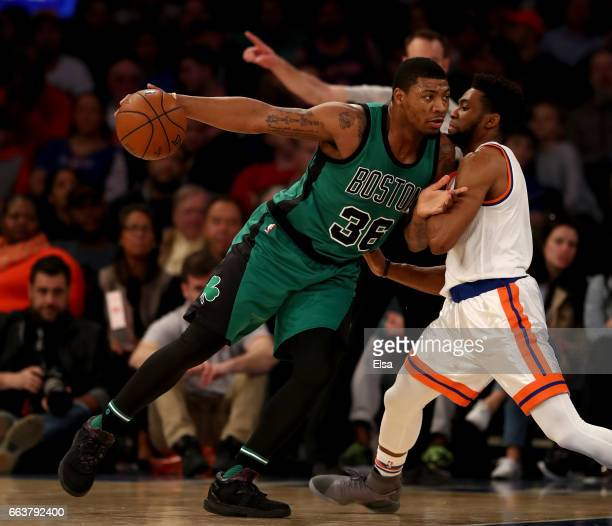 Marcus Smart of the Boston Celtics drives as Chasson Randle of the New York Knicks defends at Madison Square Garden on April 2 2017 in New York City...