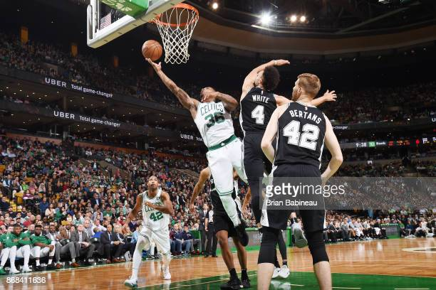 Marcus Smart of the Boston Celtics drives to the basket against the San Antonio Spurs on October 30 2017 at the TD Garden in Boston Massachusetts...