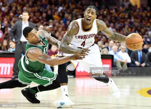 Marcus Smart of the Boston Celtics fouls Iman Shumpert of the Cleveland Cavaliers in the second half during Game Three of the 2017 NBA Eastern...