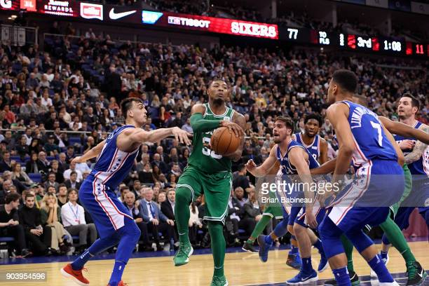 Marcus Smart of the Boston Celtics goes to the basket against the Philadelphia 76ers during the 2018 NBA London Game at the 02 Arena on January 11...