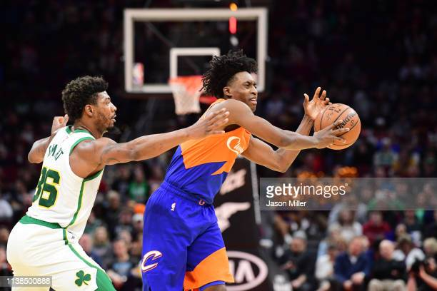 Marcus Smart of the Boston Celtics guards Collin Sexton of the Cleveland Cavaliers during the first half at Quicken Loans Arena on March 26 2019 in...