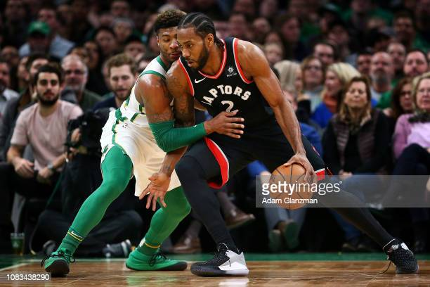 Marcus Smart of the Boston Celtics guards Kawhi Leonard of the Toronto Raptors during a game at TD Garden on January 16 2019 in Boston Massachusetts...