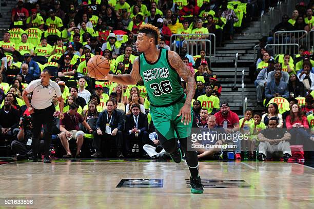 Marcus Smart of the Boston Celtics handles the ball against the Atlanta Hawks in Game One of the Eastern Conference Quarterfinals during the 2016 NBA...