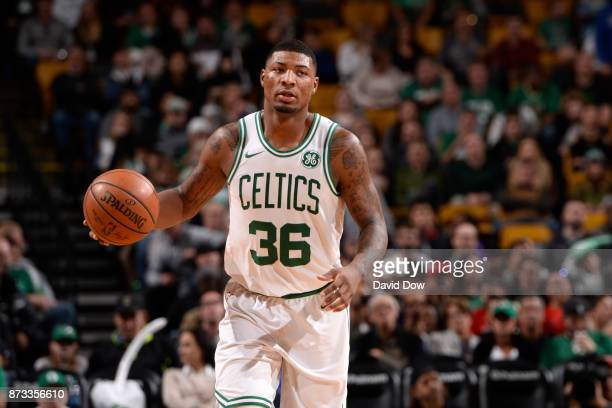 Marcus Smart of the Boston Celtics handles the ball against the Toronto Raptors on November 12 2017 at the TD Garden in Boston Massachusetts NOTE TO...