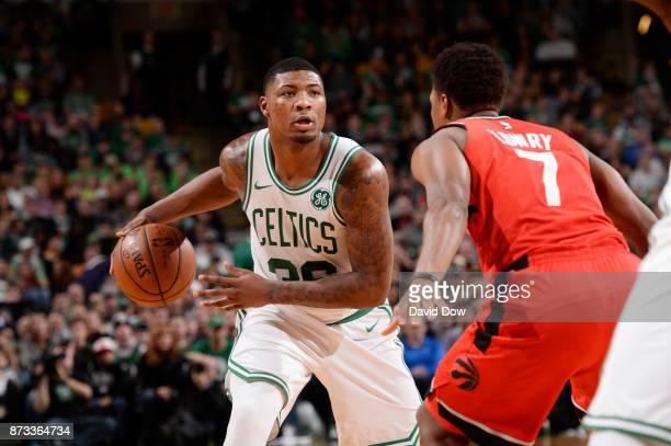 Marcus Smart of the Boston Celtics handles the ball against the Toronto Raptors on November 12 2017 at the TD Garden in Boston Massachusetts NOTE TO...