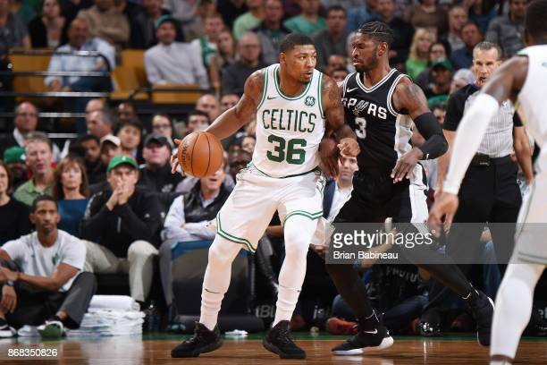 Marcus Smart of the Boston Celtics handles the ball against the San Antonio Spurs on October 30 2017 at the TD Garden in Boston Massachusetts NOTE TO...