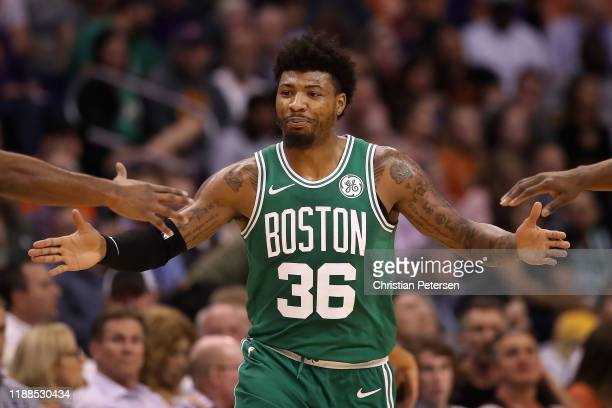 Marcus Smart of the Boston Celtics high fives teammates after scoring against the Phoenix Suns during the first half of the NBA game at Talking Stick...