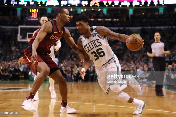 Marcus Smart of the Boston Celtics is defended by Rodney Hood of the Cleveland Cavaliers during the fourth quarter in Game One of the Eastern...