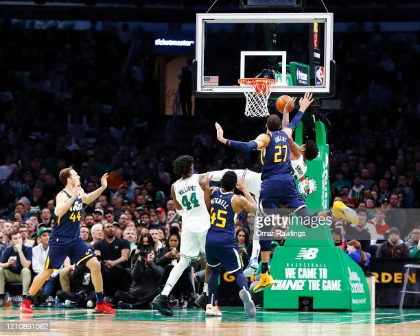 Marcus Smart of the Boston Celtics is fouled during the fourth quarter of the game against the Utah Jazz at TD Garden on March 06 2020 in Boston...