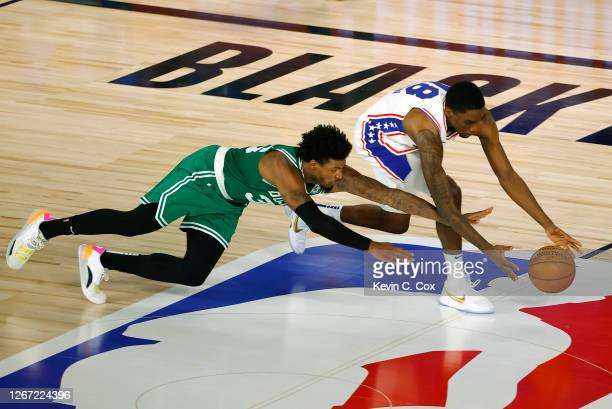 Marcus Smart of the Boston Celtics knocks the ball loose form Shake Milton of the Philadelphia 76ers during the second quarter in Game Two of the...