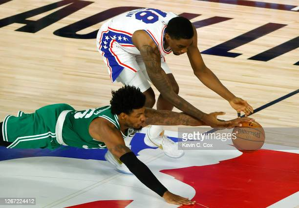 Marcus Smart of the Boston Celtics knocks the ball loose from Shake Milton of the Philadelphia 76ers during the second quarter in Game Two of the...