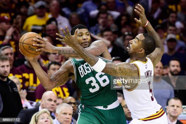 Marcus Smart of the Boston Celtics looks to pass against JR Smith of the Cleveland Cavaliers in the second half during Game Three of the 2017 NBA...
