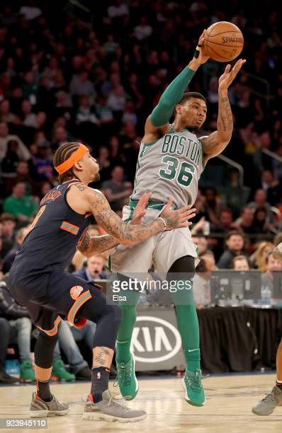 Marcus Smart of the Boston Celtics passes as Michael Beasley of the New York Knicks defends at Madison Square Garden on February 242018 in New York...