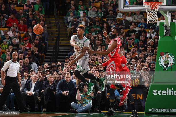Marcus Smart of the Boston Celtics passes the ball against the Houston Rockets on March 11 2016 at the TD Garden in Boston Massachusetts NOTE TO USER...