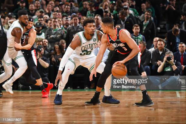 Marcus Smart of the Boston Celtics plays defense against CJ McCollum of the Portland Trail Blazers on February 27 2019 at the TD Garden in Boston...