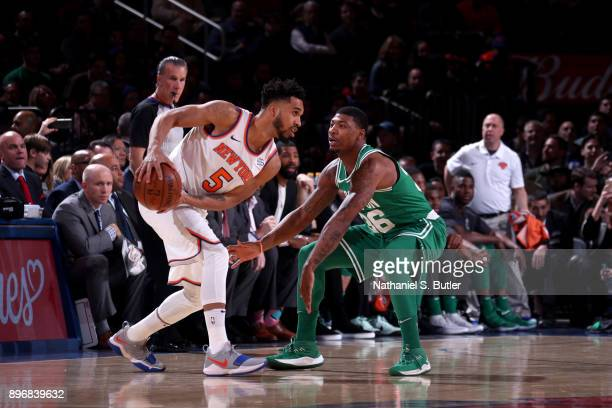 Marcus Smart of the Boston Celtics plays defense against the New York Knicks on December 21 2017 at Madison Square Garden in New York City New York...