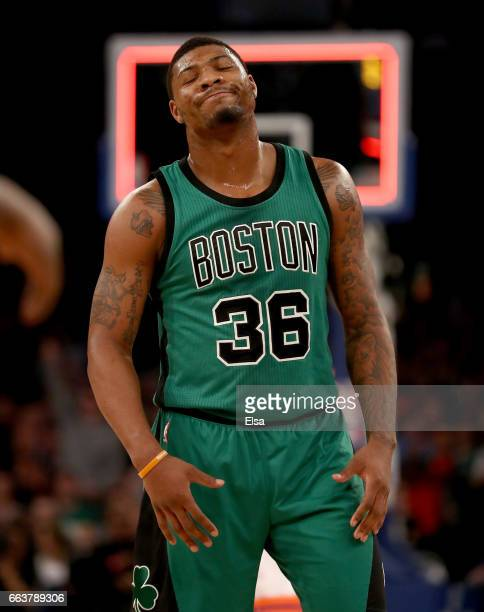 Marcus Smart of the Boston Celtics reacts after the Celtics were not able to score before the first quarter ended against the New York Knicks at...