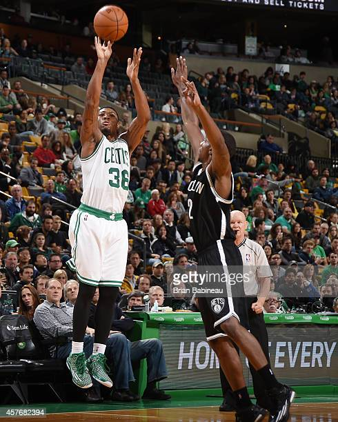 Marcus Smart of the Boston Celtics shoots against Markel Brown of the Brooklyn Nets during the game on October 22 2014 at the TD Garden in Boston...