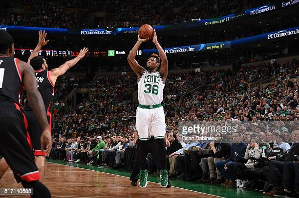 Marcus Smart of the Boston Celtics shoots against the Toronto Raptors on March 23 2016 at the TD Garden in Boston Massachusetts NOTE TO USER User...