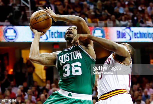 Marcus Smart of the Boston Celtics shoots against Tristan Thompson of the Cleveland Cavaliers in the second quarter during Game Four of the 2017 NBA...