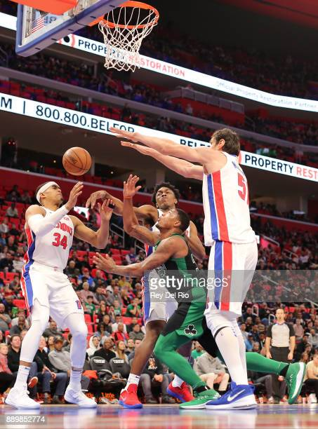 Marcus Smart of the Boston Celtics shoots the ball a draws a foul from Boban Marjanovic of the Detroit Pistons at Little Caesars Arena on December 10...