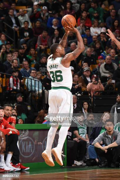 Marcus Smart of the Boston Celtics shoots the ball against the Houston Rockets on December 28 2017 at the TD Garden in Boston Massachusetts NOTE TO...