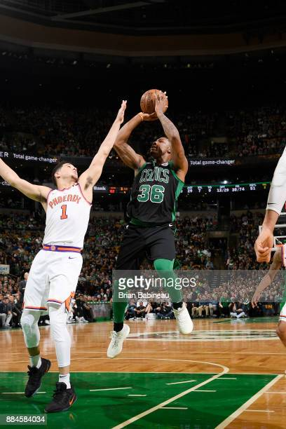 Marcus Smart of the Boston Celtics shoots the ball against the Phoenix Suns on December 2 2017 at the TD Garden in Boston Massachusetts NOTE TO USER...