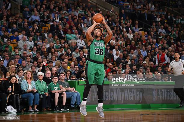 Marcus Smart of the Boston Celtics shoots the ball during a game against the Golden State Warriors on November 18 2016 at TD Garden in Boston...