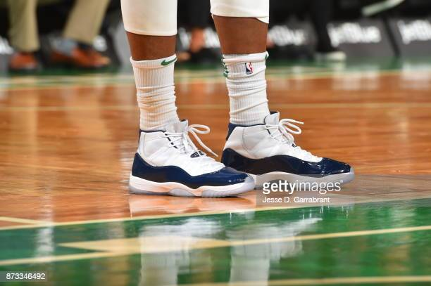 Marcus Smart of the Boston Celtics showcases his sneakers during the game against the Toronto Raptors on November 12 2017 at the TD Garden in Boston...
