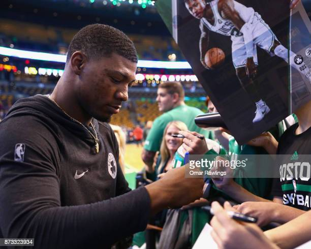 Marcus Smart of the Boston Celtics signs autographs before the game against the Toronto Raptors at TD Garden on November 12 2017 in Boston...