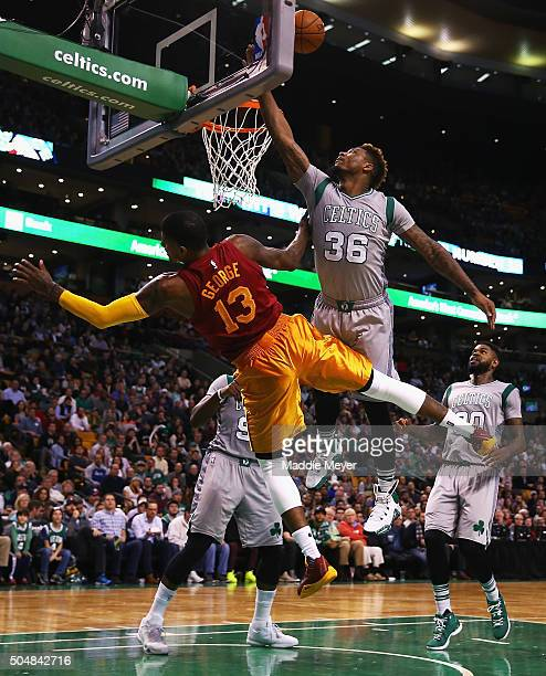 Marcus Smart of the Boston Celtics takes a shot over Paul George of the Indiana Pacers during the third quarter at TD Garden on January 13 2016 in...